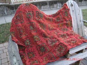 crocheted afghan in fall colors from beverlybochenek.com